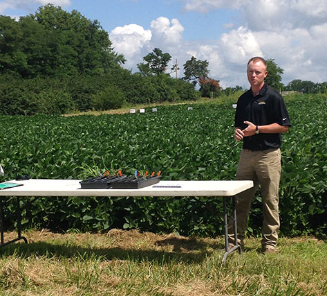 Graduate student Jaime Farmer presents results from his tillage research at the 2014 Mizzou IPM Field Day.